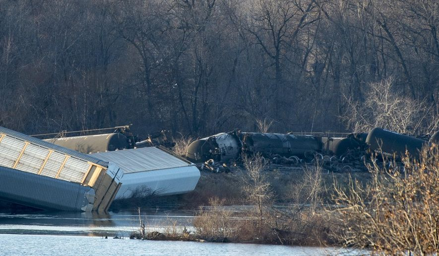 Train cars lie overturned outside of Alma, Wis. after derailing on Saturday, Nov. 7, 2015. BNSF Railway said multiple tanker cars leaked ethanol into the Mississippi River on Saturday. (Aaron Lavinsky/Star Tribune via AP)