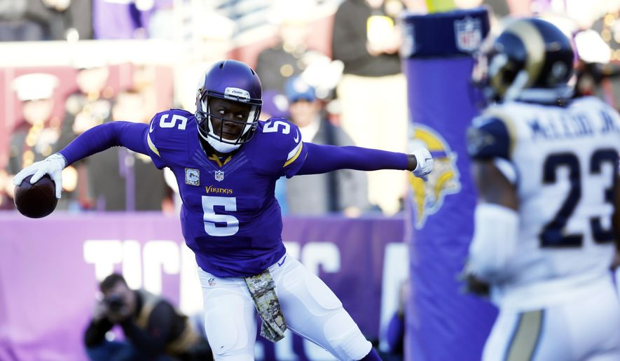 Minnesota Vikings quarterback Teddy Bridgewater (5) prepares to spike the ball after scoring on a run during the second half of an NFL football game against the St. Louis Rams, Sunday, Nov. 8, 2015, in Minneapolis. (AP Photo/Jim Mone)