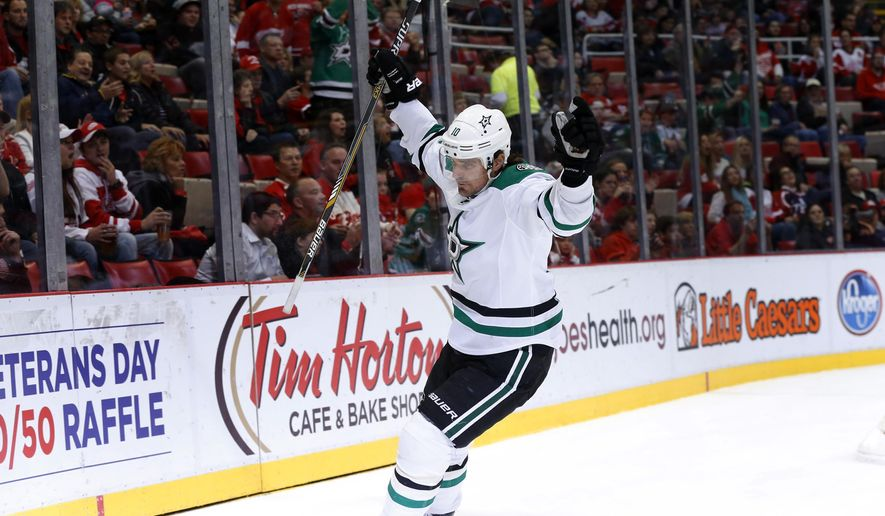 Dallas Stars' Patrick Sharp celebrates his goal against the Detroit Red Wings in the first period of an NHL hockey game Sunday, Nov. 8, 2015, in Detroit. (AP Photo/Paul Sancya)