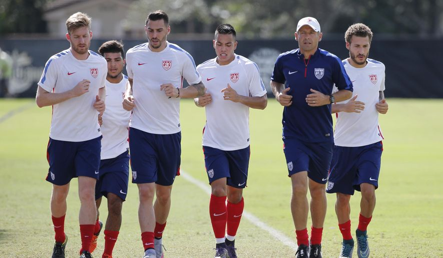 U.S. men's national soccer team coach Jurgen Klinsmann, second from right, jogs around the field with players during practice, Monday, Nov. 9, 2015, at Barry University in Miami Shores, Fla. The team plays Friday in St. Louis against St. Vincent and the Grenadines, then plays four days later at Trinidad and Tobago. Klinsmann brought the team to Barry University, wanting two days of training in heat and humidity ahead of next week's game in Port-of-Spain. (AP Photo/Wilfredo Lee)