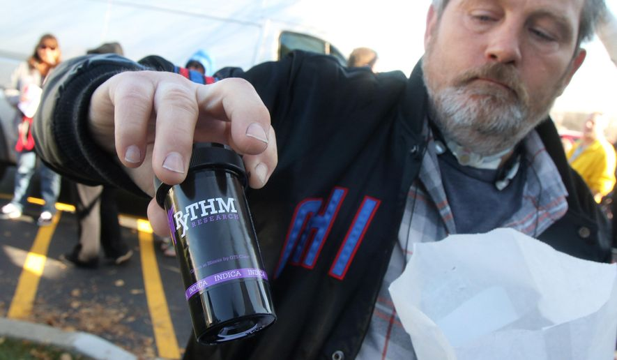 Island Lake, Ill., resident Ron Lindstaedt shows his prescription of medical marijuana, called Grape God Bud, after the opening of opening of The Clinic Mundelein, a medical marijuana dispensary Monday, Nov. 9, 2015 in Mundelein, Ill. Regulated medical marijuana sales began Monday in Illinois with patients flocking to state-licensed retail shops in five cities around the state. Besides Mundelein, retail shops in Canton, Marion, Addison, and Quincy were first to open with possibly 25 opening by the end of the year. (Gilbert R. Boucher II/Daily Herald, via AP)  MANDATORY CREDIT, MAGS OUT