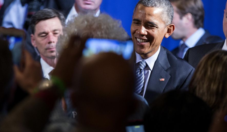President Barack Obama shakes hands after speaking during a Organizing for Action event, on Monday, Nov. 9, 2015, in Washington. Obama thanked the organization for their work in promoting his policies. (AP Photo/Evan Vucci)