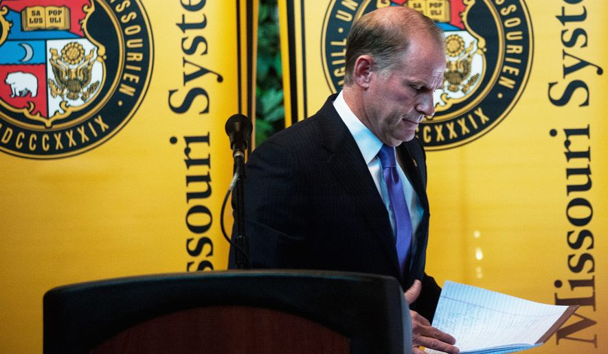 """Please, please, use this resignation to heal, not to hate, and let's moe on together for a brighter tomorrow,"" University of Missouri System President Tim Wolfe said in announcing his resignation Monday, under fire for his handling of race complaints. (Columbia Daily Tribune via Associated Press)"