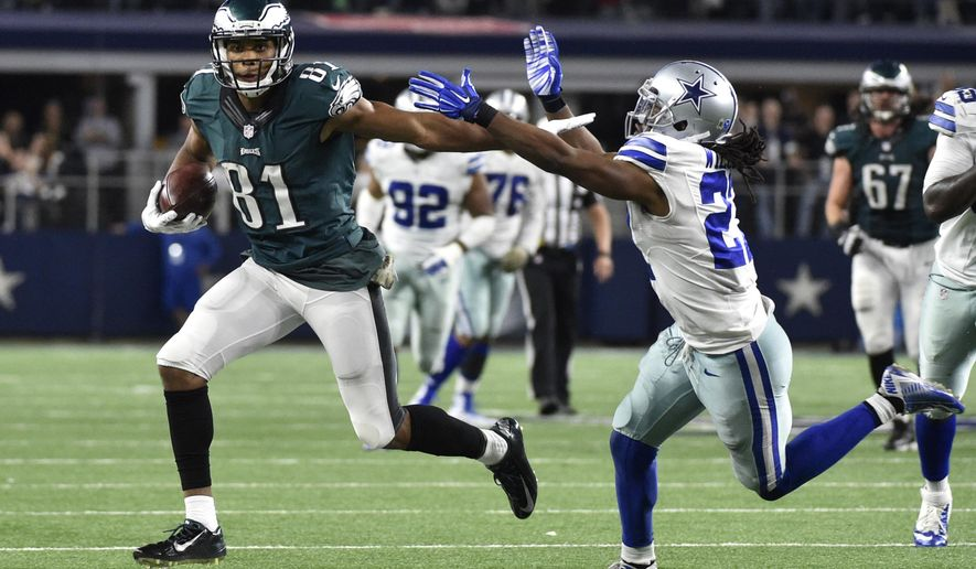 Philadelphia Eagles' Jordan Matthews (81) fights off a tackle attempt by Dallas Cowboys' J.J. Wilcox as Matthews heads to the end zone for a touchdown in overtime of an NFL football game, Sunday, Nov. 8, 2015, in Arlington, Texas. The Eagles won 33-27. AP Photo/Michael Ainsworth)