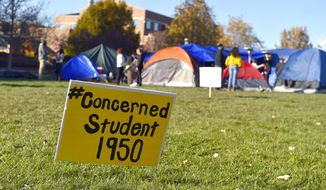 A sign is posted where student protesters have put up tents on the University of Missouri campus Sunday, Nov. 8, 2015, in Columbia, Mo. Student protests over racial incidents on the campus escalated over the weekend when some football players announced they will not participate in team activities until the school's President Tim Wolfe is removed. (Allison Long/The Kansas City Star via AP) MANDATORY CREDIT
