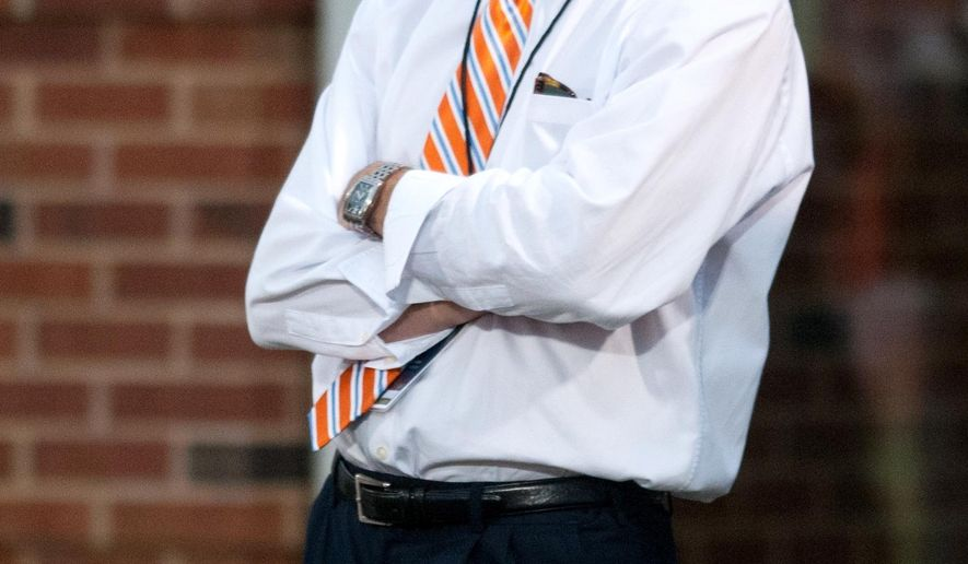 """FILE - In this Sept. 26, 2015, file photo, Illinois athletic director Mike Thomas watches an NCAA football game against Middle Tennessee in Champaign, Ill. Illinois fired athletic director Mike Thomas on Monday, Nov. 9, 2015, as it prepares to release the final report from its investigation into mistreatment of football and women's basketball players. Interim Chancellor Barbara Wilson said that the report found no wrongdoing by Thomas. But she says """"a change in leadership was needed in order to move forward."""" (AP Photo/Bradley Leeb, File)"""
