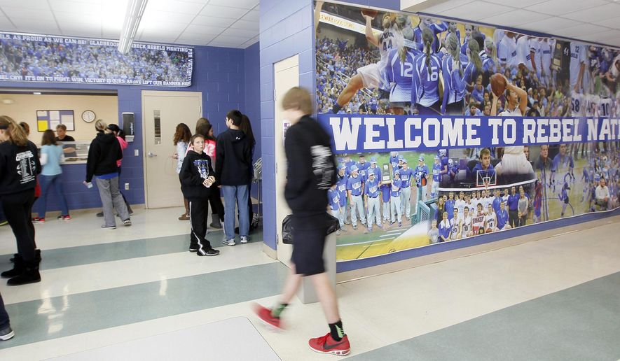 In this Nov. 6, 2015 photo, students go to lunch at Gladbrook-Reinbeck Junior High and High School in Reinbeck, Iowa. The Board of Education's decision to close one of Gladbrook-Reinbeck Community Schools' three schools has prompted a petition drive to dissolve the entire district. (Brandon Pollock/The Courier via AP) MANDATORY CREDIT