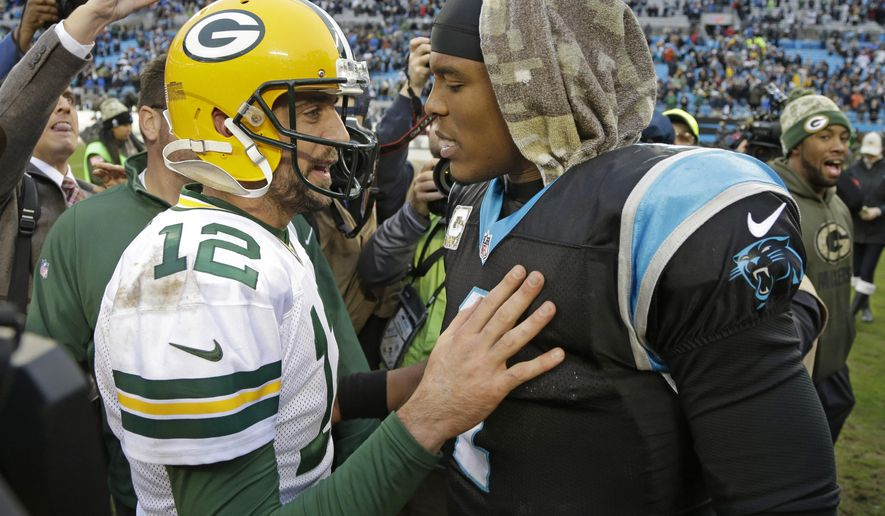 Carolina Panthers' Cam Newton, right, talks with Green Bay Packers' Aaron Rodgers, left, after an NFL football game in Charlotte, N.C., Sunday, Nov. 8, 2015. The Panthers won 37-29. (AP Photo/Bob Leverone)