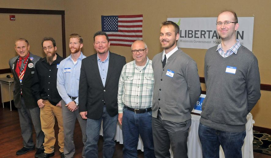 North Dakota Libertarian Party candidates for statewide offices from right, Joshua Voytek, Nick Bata, Robert Marquette, Jack Seaman, Tom Skadeland, Kevin Johnson and Roland Riemers pose for a photo as they attend the North Dakota Libertarian convention in Mandan, N.D., Saturday, Nov. 7, 2015. (Tom Stromme/The Bismarck Tribune via AP) MANDATORY CREDIT