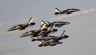 "The ""Frecce Tri Colori"" Italian Air Force aerobatic display team perform during the opening of the Dubai Airshow in Dubai, United Arab Emirates, Sunday, Nov. 8, 2015. (AP Photo/Kamran Jebreili)"