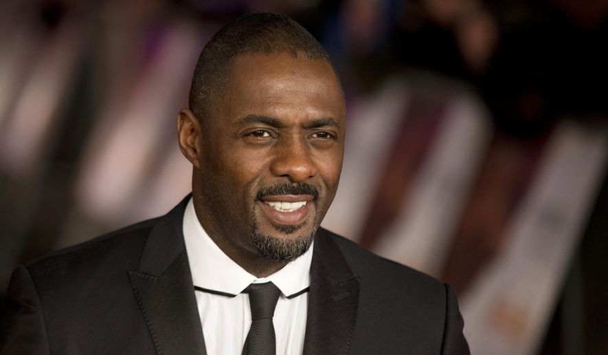 """FILE- In this file photo photo dated Thursday, Dec. 5, 2013, British actor Idris Elba who plays Nelson Mandela in the movie """"Mandela: Long Walk to Freedom"""", poses for photographers in London. Elba is co-starring with Madonna on stage - not screen. The actor-musician will be the opening act during her """"Rebel Heart"""" tour stop Tuesday, Nov. 10, 2015, at the Mercedes Benz Arena in Berlin, Germany.  (AP Photo/Matt Dunham, File)"""