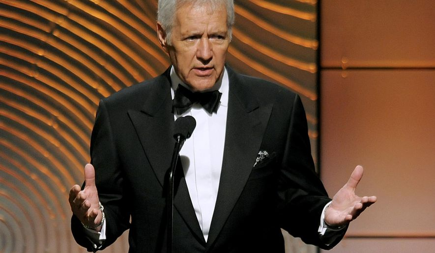 """FILE - In a Sunday, June 16, 2013 file photo, Jeopardy! host Alex Trebek speaks on stage at the 40th Annual Daytime Emmy Awards, in Beverly Hills, Calif. """"Jeopardy!"""" and """"Wheel of Fortune"""", in cooperation with the veterans' support campaign Got Your 6, are using the week of Nov. 9, 2015 episodes to spotlight those who have served. (Photo by Chris Pizzello/Invision/AP, File)"""