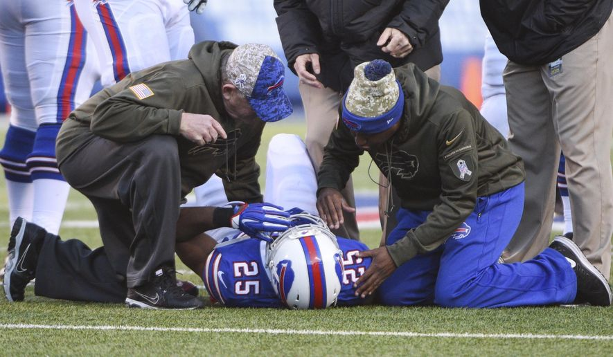 Trainers help Buffalo Bills' LeSean McCoy (25) after he was injured during the second half of an NFL football game against the Miami Dolphins, Sunday, Nov. 8, 2015, in Orchard Park, N.Y. (AP Photo/Gary Wiepert)