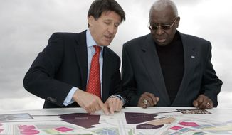 FILE - In this May 15, 2009 file photo Sebastian Coe Chairman of the London 2012 Organizing Committee of the Olympic Games, left, talks with Lamine Diack President of the IAAF as they look at a map of the site of the London 2012 Olympics in  London. Former IAAF President Lamine Diack was put under criminal investigation last week on suspicion of corruption and money laundering amid allegations linking his sons to extorting money from athletes who tested positive for doping. (AP Photo/Alastair Grant)