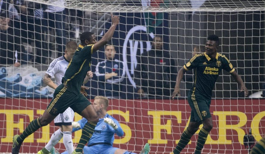 Portland Timbers FC Fanendo Adi (9) celebrates his goal past Vancouver Whitecaps goalkeeper David Ousted (1) during the first half of MLS soccer action in Vancouver, British Columbia, Canada, Sunday, Nov. 8, 2015. (Jonathan Hayward/The Canadian Press via AP)
