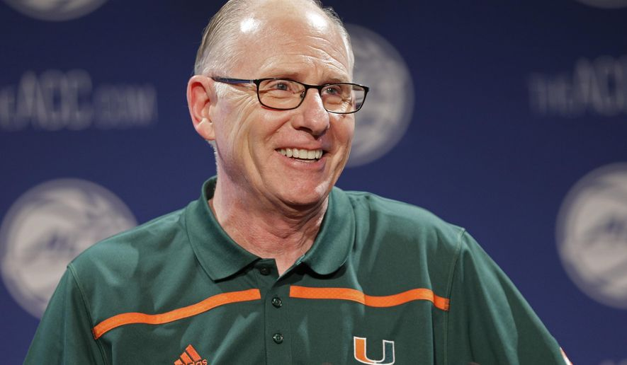 """FILE - In this Oct. 28, 2015, file photo, Miami NCAA college basketball coach Jim Larranaga answers a question during the Atlantic Coast Conference men's media day in Charlotte, N.C. Miami was picked fifth in the Atlantic Coast Conference's preseason rankings, is flirting with the Top 25 in the major national polls and is widely expected to be an NCAA Tournament team. """"It doesn't happen overnight,"""" Larranaga said. """"This is our fifth year. And we can see the progress we've made."""" (AP Photo/Chuck Burton, File)"""