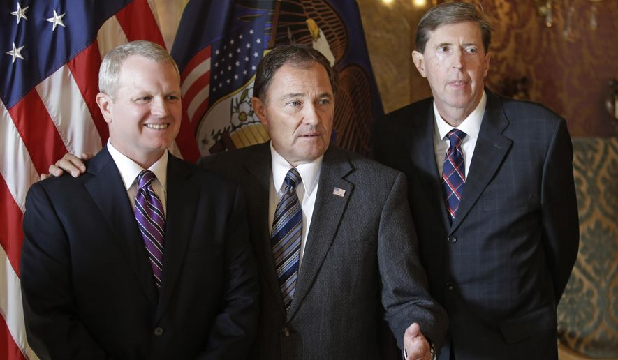 Gov. Gary Herbert, center, poses with John Pearce, left, his nominee to fill a vacancy on the Utah Supreme Court, as Chief Justice Matthew Durrant, right, looks on during a news conference at the Utah State Capitol, Monday, Nov. 9, 2015, in Salt Lake City. Pearce currently serves as a judge on the Utah Court of Appeals. He will replace Justice Jill Parrish, who left the state Supreme Court after she became a federal judge in Utah in August. (AP Photo/Rick Bowmer)