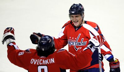 Washington Capitals' Sergei Fedorov of Russia, right, celebrates his goal with Alex Ovechkin (8) of Russia against the Boston Bruins during the first period of a NHL hockey game, Sunday, March 16, 2008, in Washington.(AP Photo/Nick Wass)