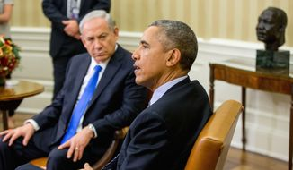 President Barack Obama speaks to members of the media as he meets with Israeli Prime Minister Benjamin Netanyahu in the Oval Office of the White House in Washington, Monday, Nov. 9, 2015. The president and prime minister sought to mend their fractured relationship during their meeting, the first time they have talked face to face in more than a year. (AP Photo/Andrew Harnik)