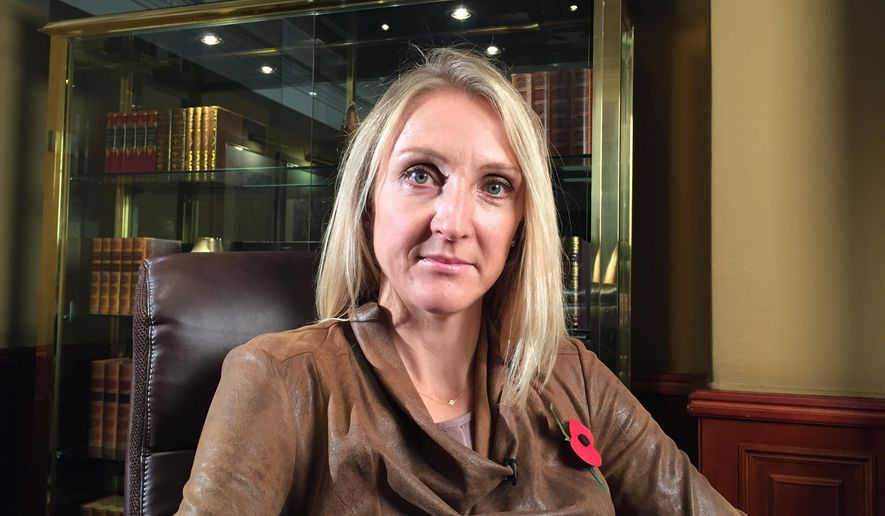 Paula Radcliffe, the women's marathon world record holder, poses before an interview with The Associated Press in London, on Monday, Nov. 9 2015 in which she discussed the World Anti-Doping Agency report that exposed widespread and systematic state-supported doping in Russian athletics. (AP Photo/Rob Harris)