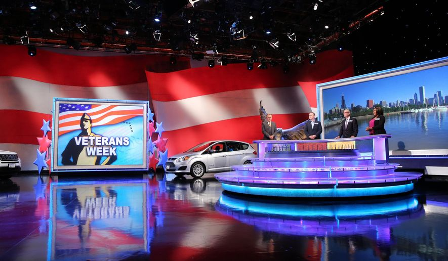"""This 2015 photo provided by Wheel of Fortune shows, Pat Sajak, left, with  three veteran contestants on the set of the television series, """"Wheel of Fortune,"""" honoring veterans for Veterans Day. (Carol Kaelson/Wheel of Fortune via AP)"""