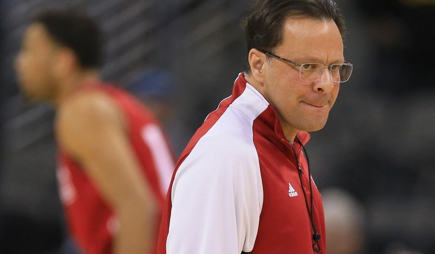 FILE - In this March 19, 2015, file photo, Indiana coach Tom Crean follows his players during practice for an NCAA college basketball tournament second round game in Omaha, Neb. The hottest seat in college basketball this season belongs to Indiana's Tom Crean _ just like last season. (AP Photo/Nati Harnik, File)