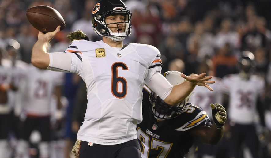 Chicago Bears quarterback Jay Cutler (6) throws a pass under pressure from San Diego Chargers outside linebacker Jeremiah Attaochu during the first half of an NFL football game Monday, Nov. 9, 2015, in San Diego. (AP Photo/Denis Poroy)