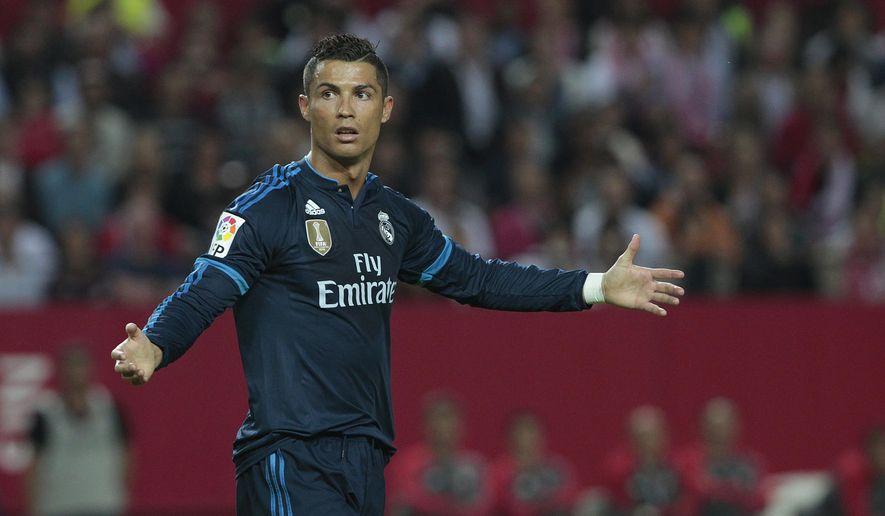 Real Madrid's Cristiano Ronaldo gestures during their La Liga soccer match against Sevilla at the Ramon Sanchez Pizjuan stadium, in Seville, Spain on Sunday, Nov. 8, 2015. (AP Photo/Angel Fernandez)