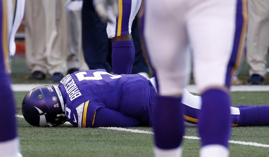 FILE - In this Nov. 8, 2015, file photo, Minnesota Vikings quarterback Teddy Bridgewater lies on the field after a hit during the second half of an NFL football game against the St. Louis Rams, in Minneapolis. Bridgewater sustained a concussion.  (AP Photo/Ann Heisenfelt, File)