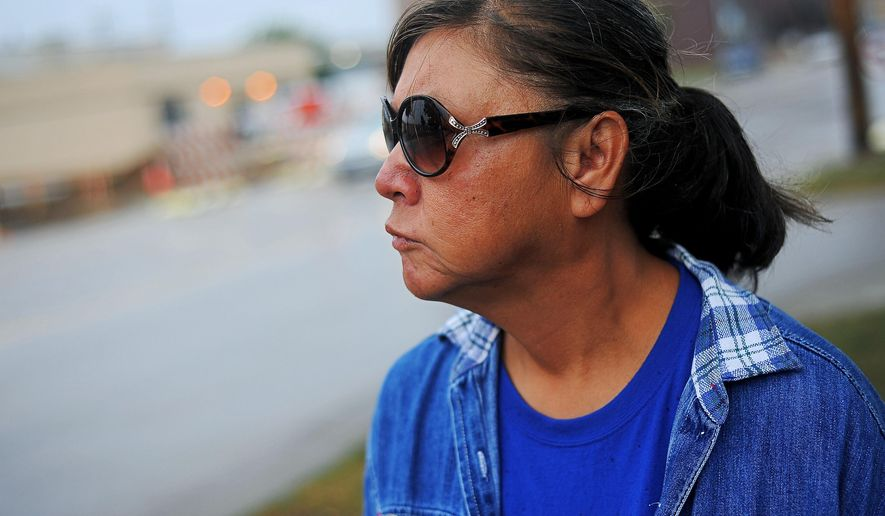 Donna Rose Peniska, who has been living on the streets for about five years, walks along East 8th Street Wednesday, Sept. 23, 2015, in Sioux Falls, S.D. Peniska, who has been arrested multiple times for trespassing, said that she's always afraid of getting a ticket for something. Trespassing arrests in Sioux Falls have surged since the city began cracking down on people deemed to be a nuisance, and some believe the homeless community is being unfairly targeted. (Joe Ahlquist/Argus Leader via AP)