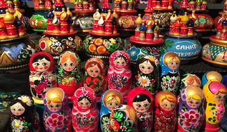 This Oct. 31, 2015 photo shows souvenirs, including the famous Russian nesting dolls, for sale in St. Petersburg, Russia. Other stalls feature fur hats and T-shirts showing President Vladimir Putin. (AP Photo/Cara Anna)