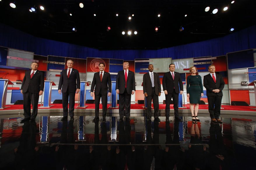Republican presidential candidates John Kasich, Jeb Bush, Marco Rubio, Donald Trump, Ben Carson, Ted Cruz, Carly Fiorina and Rand Paul take the stage before the Republican presidential debate at the Milwaukee Theatre on Tuesday in Milwaukee. (Associated Press)