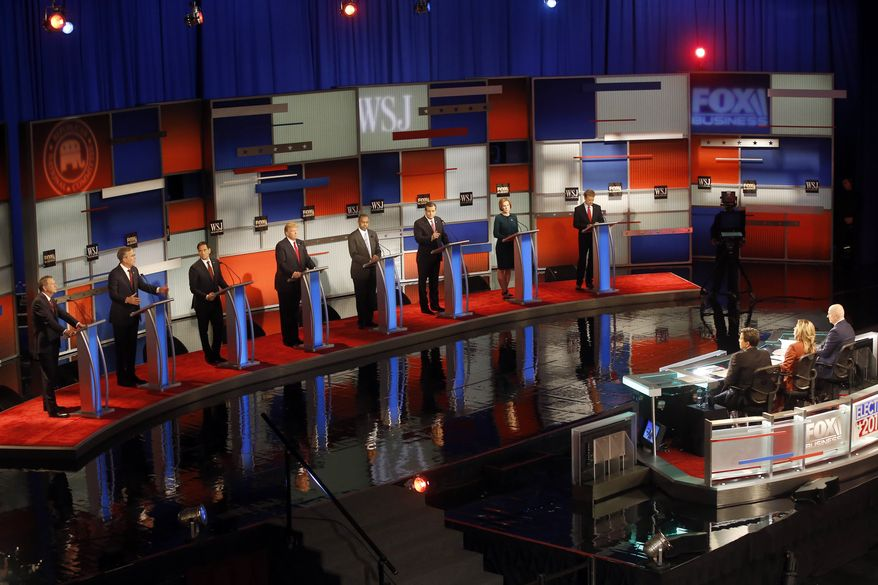 Republican presidential candidates John Kasich, Jeb Bush, Marco Rubio, Donald Trump, Ben Carson, Ted Cruz, Carly Fiorina and Rand Paul appear during Republican presidential debate at Milwaukee Theatre on Tuesday, Nov. 10, 2015, in Milwaukee. (Associated Press)