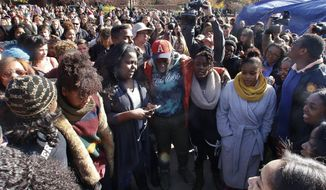 Supporters gather after the announcement that University of Missouri System President Tim Wolfe would resign Monday, Nov. 9, 2015, in Columbia, Mo. Wolfe resigned Monday with the football team and others on campus in open revolt over his handling of racial tensions at the school. (Matt Hellman/Missourian via AP) ** FILE **