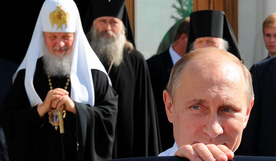 Amid a formerly strongly atheistic society, Russia's President Vladimir Putin has lately been cozying up to the Russian Orthodox Church. (Associated Press)