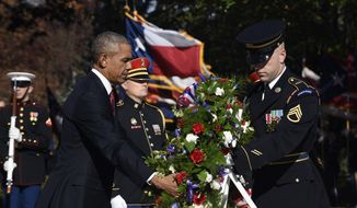 President Obama laid a wreath at the Tomb of the Unknowns at Arlington National Cemetery on Wednesday as part of Veterans Day ceremonies. (Associated Press)