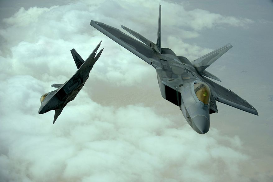 U.S. Air Force F-22 Raptors fly in formation during a training mission, Dec. 6, 2009.  The F-22 fighters and crews are deployed from the 27th Fighter Squadron at Langley Air Force Base, Va., and in the Air Forces Central area of responsibility for the first time as part of a multinational exercise where aircrews from France, Jordan, Pakistan, the U.A.E., the U.K., and the U.S. trained together in fighting a large-scale air war.  (U.S. Air Force photo by Staff Sgt. Michael B. Keller) **FILE**