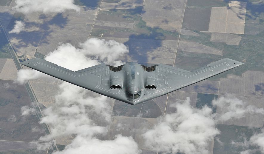 The Northrop Grumman B-2 Spirit, also known as the Stealth Bomber, is an American heavy strategic bomber, featuring low observable stealth technology designed for penetrating dense anti-aircraft defenses. It is a flying wing design with a crew of two. (Northrop Grumman) ** FILE **