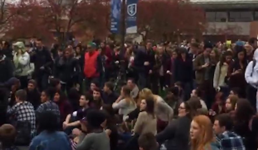 Hundreds of Ithaca College students protested on campus Wednesday to demand the resignation of college President Tom Rochon, voicing concerns of systemic racism and a lack of racial diversity in top positions at the college. (Twitter screengrab/@anaborruto)
