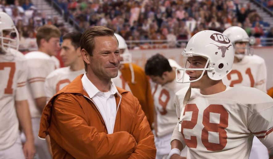 """""""My All-American"""" stars Aaron Eckhart as University of Texas football coach Darrell Royal and Finn Wittrock as player Freddie Steinmark. The film is based on a real-life story."""