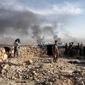 Smoke rises over Sinjar, northern Iraq from oil fires set by Islamic State militants as Kurdish Iraqi fighters, backed by U.S.-led airstrikes, launch a major assault on Thursday, Nov. 12, 2015. The strategic town of Sinjar was overran last year by the Islamic State group in an onslaught that caused the flight of tens of thousands of Yazidis and first prompted the United States to launch the air campaign against the militants. (AP Photo/Bram Janssen) ** FILE **
