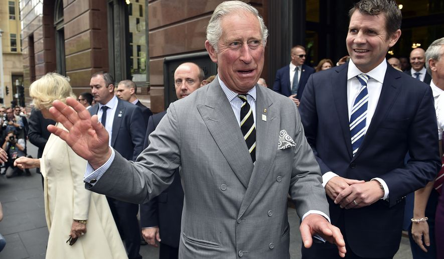 Britain's Prince Charles, center, smiles as he meets well-wishers during a walk around Martin Place in Sydney, Thursday, Nov. 12, 2015. Prince Charles and his wife Camilla, Duchess of Cornwall are on a six-day visit to Australia. (Saeed Khan/Pool Photo via AP)