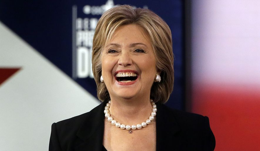 Hillary Rodham Clinton reminded her critics during the Democratic presidential debate Saturday night that she helped Wall Street after the 9/11 attacks. (Associated Press)