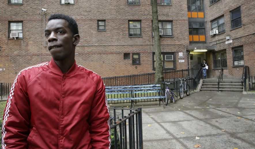 Kaamar Lebrew speaks to The Associated Press outside the New York City Housing Authority's Chelsea-Elliot Houses where he lives, Thursday, Nov. 12, 2015, in New York.  The Department of Housing and Urban Development proposed a rule Thursday to require the more than 3,100 public housing agencies across the country to make their properties smoke-free. (AP Photo/Mary Altaffer)