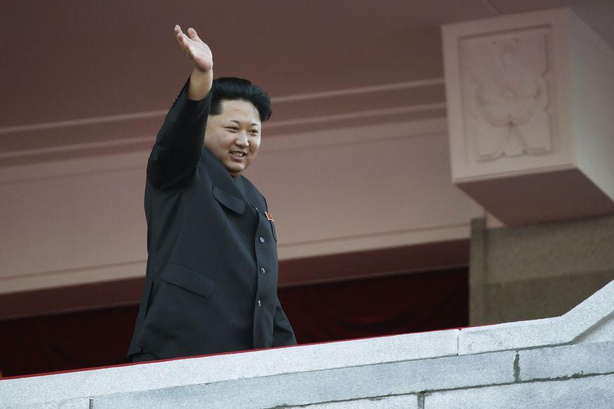 North Korean leader Kim Jong-un waves at a parade in Pyongyang, North Korea, Saturday, Oct. 10, 2015. (Associated Press)