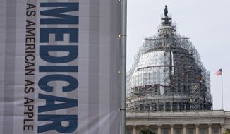In this July 30, 2015, file photo, a sign supporting Medicare is seen on Capitol Hill in Washington as registered nurses and other community leaders celebrate the 50th anniversary of Medicare and Medicaid. (AP Photo/Jacquelyn Martin, File)