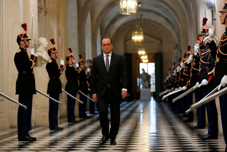 """In a rare speech to lawmakers gathered in the majestic congress room of the Palace of Versailles, French President Francois Hollande said the attacks """"were decided and planned in Syria, they were organized in Belgium and committed on our land."""" (Associated Press photographs)"""