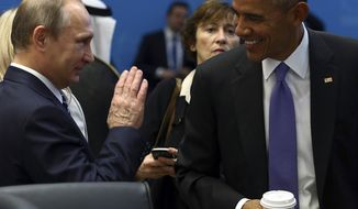 U.S. President Barack Obama, right, talks with Russian President Vladimir Putin, left, prior to a session of the G-20 Summit in Antalya, Turkey, Monday, Nov. 16, 2015. The leaders of the Group of 20 were wrapping up their two-day summit in Turkey Monday against the backdrop of heavy French bombardment of the Islamic State's stronghold in Syria. The bombings marked a significant escalation of France's role in the fight against the extremist group. (Kayhan Ozer/Anadolu Agency via AP, Pool)