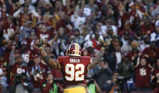Washington Redskins defensive end Chris Baker (92) celebrates a play during the second half of an NFL football game against the New Orleans Saints in Landover, Md., Sunday, Nov. 15, 2015. (AP Photo/Alex Brandon)