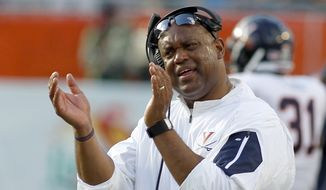 Virginia coach Mike London reacts on the sidelines in the second quarter of play against Miami in an NCAA college football game, Saturday, Nov. 7, 2015, in Miami Gardens, Fla. (AP Photo/Joe Skipper)